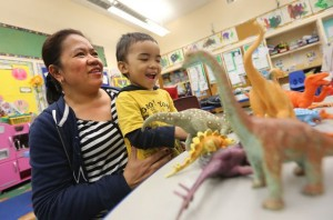 Venus Mawirat picks up her 3-year-old son Galen at APS daycare at North Preparatory Public School in Toronto.